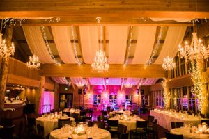 Julia_Mark_Silver_Lake_Lodge_Deer_Valley_Resort_Park_City_Utah_Dinner_Tables_Lit_By_Chandeliers_Glowing_Candles.jpg