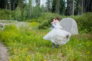 Ashley_Dan_Solitude_Resort_Solitude_Utah_Groom_Twirling_Bride_Around.jpg