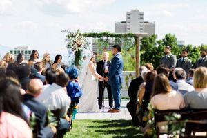 Tessa_Taani_Utah_State_Capitol_Salt_Lake_City_Utah_Ceremony_in_Front_of_Pineapple_Draped_Backdrop.jpg