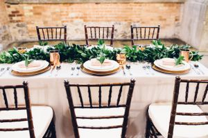 Modern_Industrial_Wedding_Shoot_The_Historic_Startup_Building_Provo_Utah_Cherrywood_Gold_Copper_Table_Setting.jpg