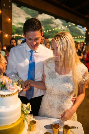 Tori_Sterling_Quiet_Meadow_Farms_Mapleton_Utah_Bride_Groom_Cutting_Cake.jpg