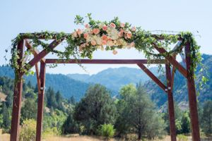 Kristin_Haven_Blacksmith_Fork_Canyon_Hyrum_Utah_Flower_Draped_Wooden_Arch.jpg