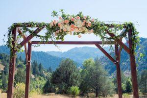 Kristin_Haven_Blacksmith_Fork_Canyon_Hyrum_Utah_Flower_Draped_Wooden_Arch.jpg