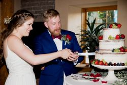 Liz_Jordan_Tracy_Aviary_Salt_Lake_City_Utah_Cake_Cutting_Bride_and_Groom.jpg