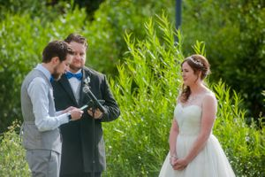 Ashley_Dan_Solitude_Resort_Solitude_Utah_Groom_Saying_Vows_at_Ceremony.jpg