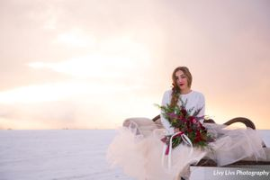 Salt_Air_Wedding_Shoot_Saltair_Resort_Salt_Lake_City_Utah_Sun_Shining_Through_Clouds_Bride_on_Swan_Fainting_Couch.jpg