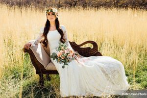 Charming_Barn_Wedding_Quiet_Meadow_Farms_Mapleton_Utah_Bride_Seated_Swan_Fainting_Couch_Field.jpg