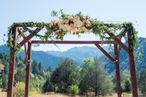Kristin_Haven_Blacksmith_Fork_Canyon_Flower_Draped_Wooden_Arch.jpg