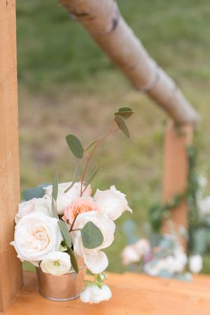 Evelyn_Kevin_Park_City_Utah_Detail_Flowers_Decorated_Wooden_Bridge.jpg