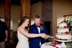 Liz_Jordan_Tracy_Aviary_Salt_Lake_City_Utah_Cutting_the_Wedding_Cake.jpg