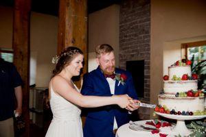 Liz_Jordan_Tracy_Aviary_Salt_Lake_City_Utah_Cutting_the_Wedding_Cake.jpg
