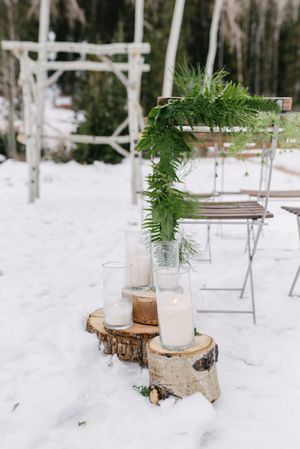 Rocky_Mountain_Bride_Winter_Elopement_Deer_Valley_Empire_Lodge_Deer_Valley_Resort_Park_City_Utah_Decor_Aspen_Arch_Lighted_Cylinder_Candles.jpg