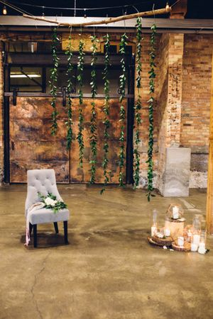 Modern_Industrial_Wedding_Shoot_The_Historic_Startup_Building_Provo_Utah_Comfortable_Chair_Candles.jpg