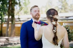 Liz_Jordan_Tracy_Aviary_Salt_Lake_City_Utah_Bride_Adjusts_Groom's_Bowtie.jpg