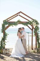 Aspyn_Steven_Bear_Lake_Utah_Couple_Kissing_Wooden_Arch.jpg