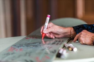 Ilana_Dave_Stein_Eriksen_Lodge_Deer_Valley_Park_City_Utah_Reception_Signing_Groom's_Snowboard.jpg