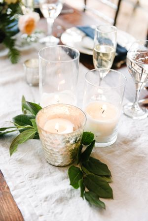 Rocky_Mountain_Bride_Winter_Elopement_Deer_Valley_Empire_Lodge_Detail_Lighted_Silver_Votive_Greenery.jpg
