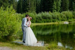 Ashley_Dan_Solitude_Resort_Solitude_Utah_Bride_Groom_Kissing_By_Mountain_Lake.jpg