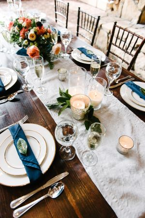 Rocky_Mountain_Bride_Winter_Elopement_Deer_Valley_Empire_Lodge_Wooden_Table_Set_With_Silver_Rimmed_Dishes.jpg