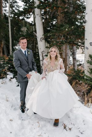 Rocky_Mountain_Bride_Winter_Elopement_Deer_Valley_Empire_Lodge_Deer_Valley_Resort_Park_City_Utah_Bride_Groom_Walking_on_Snow.jpg