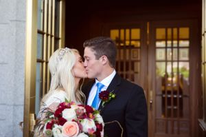 Tori_Sterling_Quiet_Meadow_Farms_Mapleton_Utah_Bride_Groom_Kissing_Temple_Doors.jpg