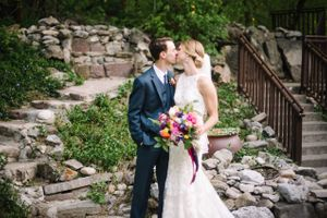 Claire_Scott_Millcreek_Inn_Salt_Lake_City_Utah_Bride_Groom_Kissing_Rock_Garden.jpg