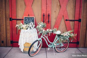 Charming_Barn_Wedding_Quiet_Meadow_Farms_Mapleton_Utah_Vignette_Table_Bicycle_Red-Accented_Barn.jpg