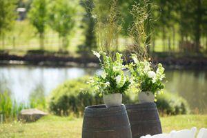 Chelsea_Walker_Red_Cliff_Ranch_Heber_City_Utah_Ceremony_Backdrop_Wine_Barrels_Potted_Plants.jpg