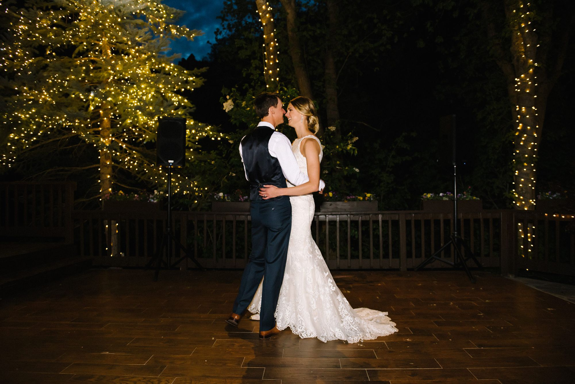 Claire_Scott_Millcreek_Inn_Salt_Lake_City_Utah_Bride_Groom_Dancing_Delicately_Lighted_Trees.jpg