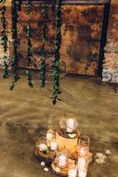 Modern_Industrial_Wedding_Shoot_The_Historic_Startup_Building_Provo_Utah_Candles_Greenery_Backdrop.jpg