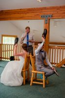 Ashley_Dan_Solitude_Resort_Solitude_Utah_Bride_Groom_Playing_Show_Quiz_Game_During_Reception.jpg