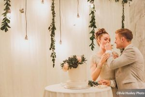 Lexie_Neil_Utah_State_Capitol_Salt_Lake_City_Utah_Bride_Groom_Feeding_Each_Other_Cake.jpg