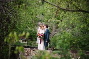 Claire_Scott_Millcreek_Inn_Salt_Lake_City_Utah_Couple_Kissing_Bridge.jpg