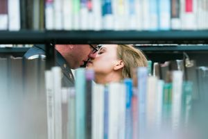 Katelyn_David_Park_City_Utah_Kissing_Between_Bookcases.jpg
