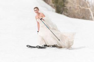 Ilana_Dave_Canyons_Resort_Park_City_Utah_Bride_Skiing_Down_Slope_in_Wedding_Dress.jpg