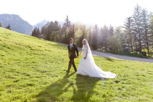 Lenora_John_Sundance_Resort_Sundance_Utah_Bride_Groom_Walking_Field.jpg