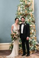 Bride and Groom in Front of Christmas