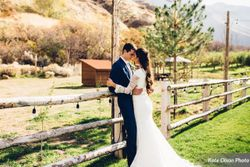 Charming_Barn_Wedding_Quiet_Meadow_Farms_Mapleton_Utah_Couple_Embracing_Fence.jpg