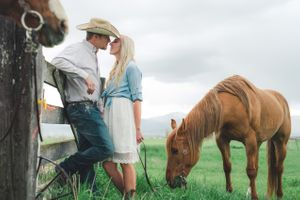 Kristin_Haven_Blacksmith_Fork_Canyon_Hyrum_Utah_Kissing_by_a_Fence.jpg
