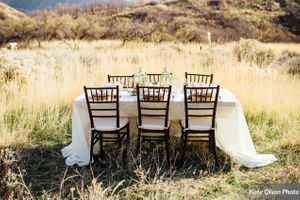 Charming_Barn_Wedding_Quiet_Meadow_Farms_Mapleton_Utah_Stylish_Table_in_Field.jpg