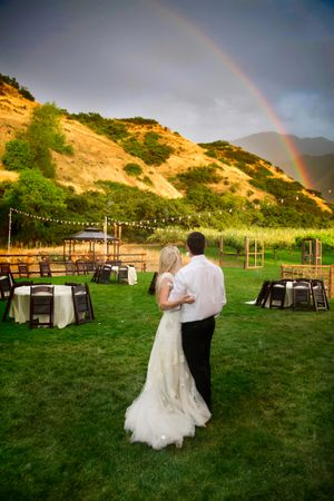 Tori_Sterling_Quiet_Meadow_Farms_Mapleton_Utah_Bride_Groom_Enjoying_Rainbow_After_Downpour.jpg