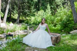 Ashley_Dan_Solitude_Resort_Solitude_Utah_Bride_Seating_on_Rock_Near_Mountain_Stream.jpg