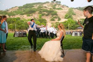 Tori_Sterling_Quiet_Meadow_Farms_Mapleton_Utah_Groom_Tosses_Garter.jpg