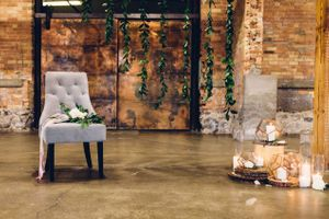 Modern_Industrial_Wedding_Shoot_The_Historic_Startup_Building_Provo_Utah_Chair_Greenery_Backdrop_Candles.jpg