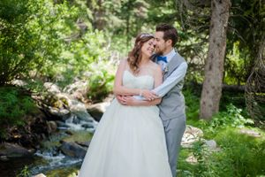 Ashley_Dan_Solitude_Resort_Solitude_Utah_Groom_Embracing_Bride.jpg
