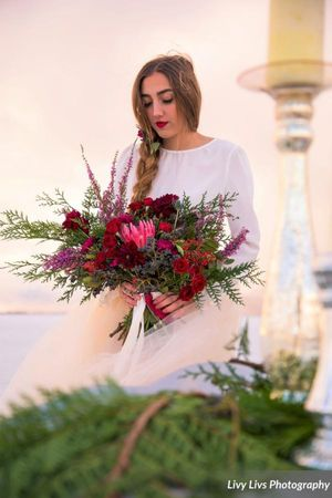 Salt_Air_Wedding_Shoot_Saltair_Resort_Salt_Lake_City_Utah_Bride_Holding_Bouquet.jpg