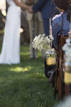 McCall_Brad_High_Star_Ranch_Kamas_Utah_Ceremony_Decor_Candle_Baby_Breath.jpg