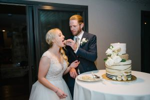 Tasha_Chip_Salt_Lake_City_Utah_Groom_Feeding_Wedding_Cake_to_Bride.jpg