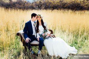Charming_Barn_Wedding_Quiet_Meadow_Farms_Mapleton_Utah_Couple_Seated_Swan_Fainting_Couch_Field.jpg