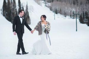 Julia_Mark_Silver_Lake_Lodge_Deer_Valley_Resort_Park_City_Utah_Bride_Groom_Walking_In_Snow.jpg